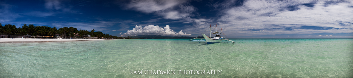 Horizontal panorama of boat in clear water in the Phillipines